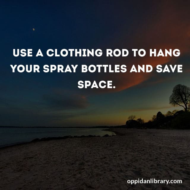 USE A CLOTHING ROD TO HANG YOUR SPRAY BOTTLES AND SAVE SPACE,