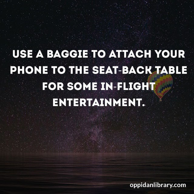 USE A BAGGIE TO ATTACH YOUR PHONE TO THE SEAT - BACK TABLE FOR SOME IN - FLIGHT ENTERTAINMENT.